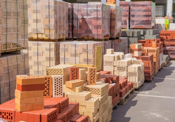 Piles of different coloured bricks - route planning for the building supplies industry