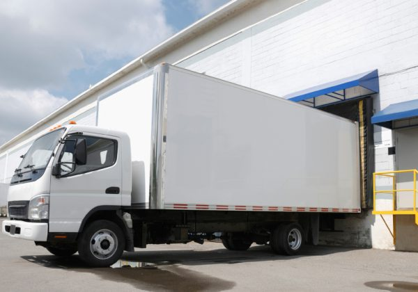 White truck at depot - routing and scheduling software for 3PLs